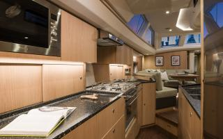 Oyster 565 Interior | Longitudinal Galley and Kitchen