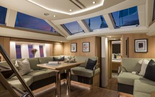 Oyster 565 Interior | Night Time Saloon Shot