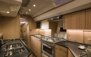 Oyster 565 Interior | Longitudinal Galley and Kitchen | Forward Shot