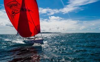 Oyster 565-01 Panthalassa with Red Spinnaker Sail