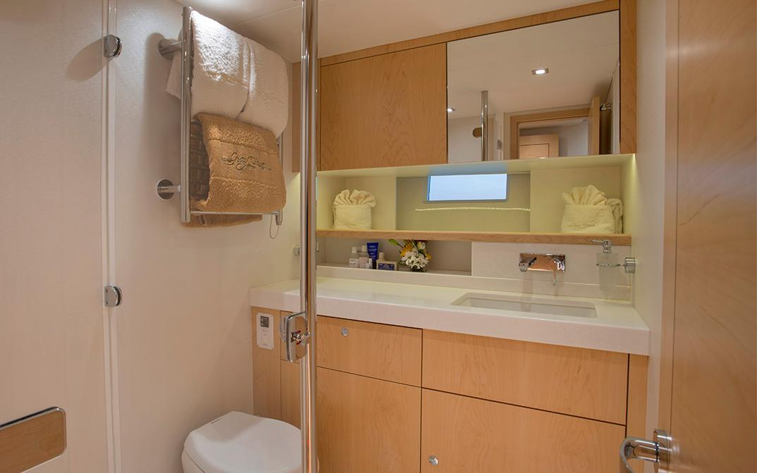 Crown Cut Maple Guest Head Bathroom on Oyster 745 Offshore Sailboat