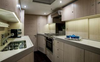 Oyster 745 Interior Kitchen Galley in Snowed Oak